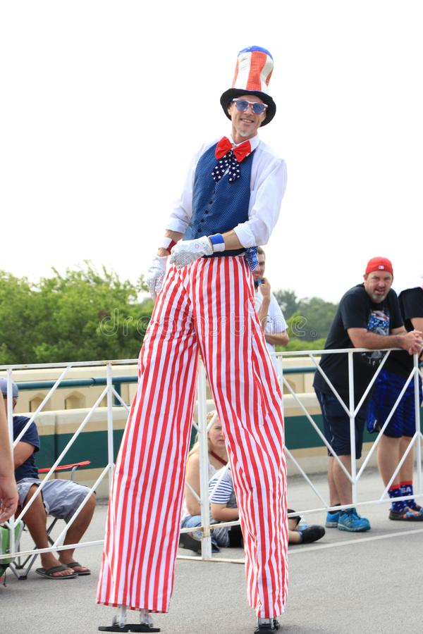 American Independence Day parade. America's Independence parade. The man dressed in a colorful costume walking on stilts in the main street of Round Rock royalty free stock photos