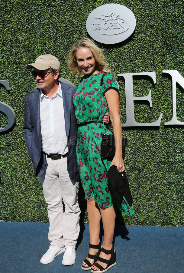 American actor, producer, and activist Michael J. Fox with his wife Tracy Pollan at the red carpet before US Open 2016 men`s final. NEW YORK - SEPTEMBER 11, 2016 royalty free stock images