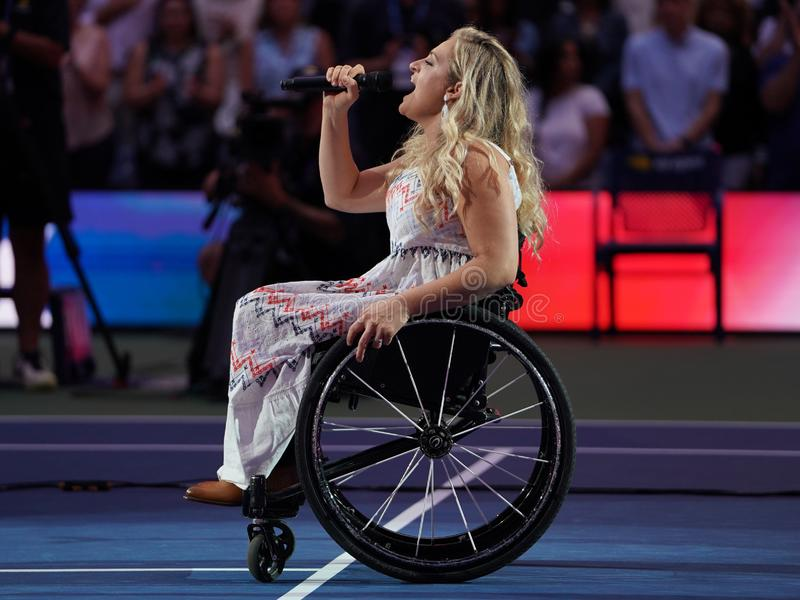 American actress and singer Ali Stroker performs the National Anthem on Opening Night at the 2019 US Open. NEW YORK - AUGUST 26, 2019. American actress and royalty free stock image