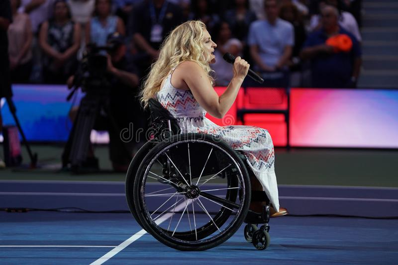 American actress and singer Ali Stroker performs the National Anthem on Opening Night at the 2019 US Open. NEW YORK - AUGUST 26, 2019. American actress and stock image
