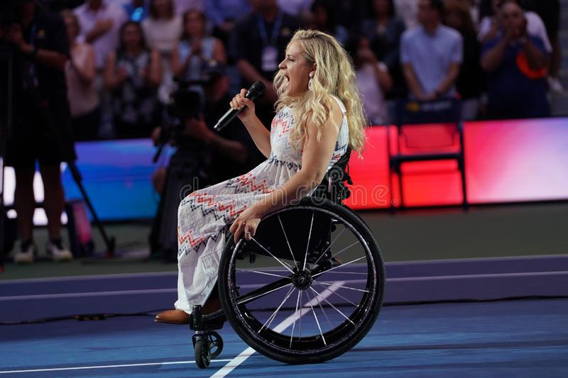 American actress and singer Ali Stroker performs the National Anthem on Opening Night at the 2019 US Open. NEW YORK - AUGUST 26, 2019. American actress and royalty free stock photography