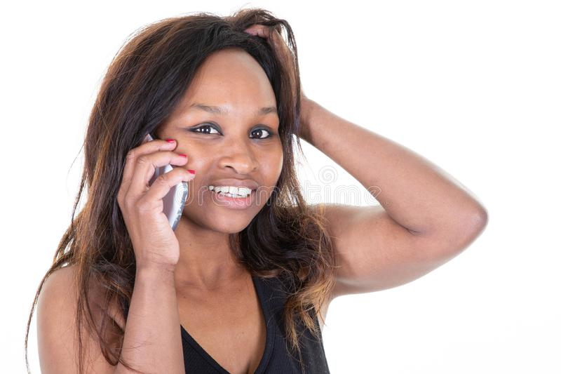American african happy woman smiling and speaking on smart mobile phone isolated over white background stock photos