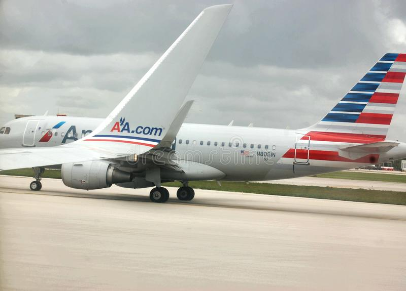 American airline logo front back sites wings. There are simultaneous back and front design of logo of American Airline company on one image , which became stock images