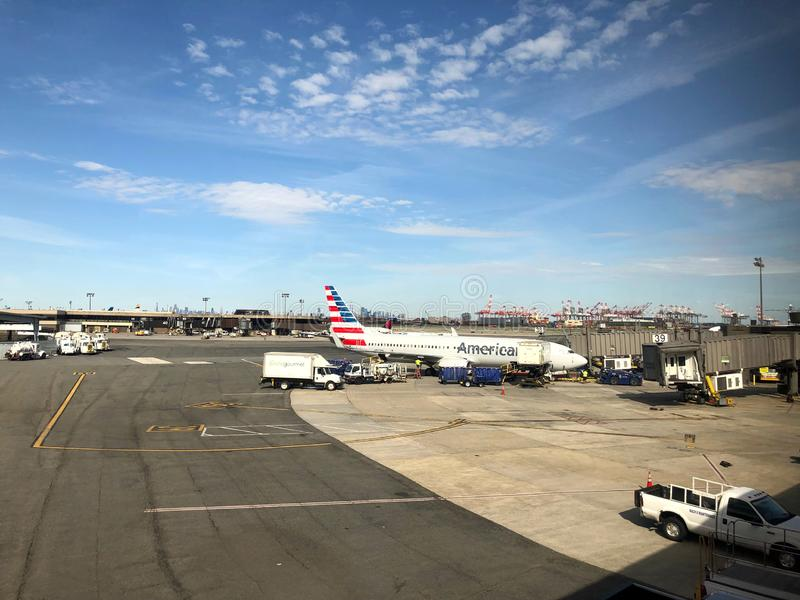 Airplane Sitting at the gate. American Airlines Airplane on tarmac ready to be boarded by flying passengers and crew at Newark Liberty International Airport stock photo
