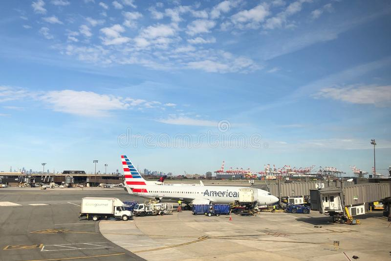 Airplane Sitting at the gate. American Airlines Airplane on tarmac ready to be boarded by flying passengers and crew at Newark Liberty International Airport stock photos