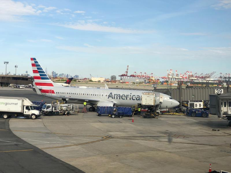 Airplane Sitting at the gate. American Airlines Airplane on tarmac ready to be boarded by flying passengers and crew at Newark Liberty International Airport royalty free stock photography