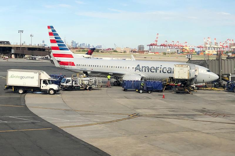 Airplane Sitting at the gate. American Airlines Airplane on tarmac ready to be boarded by flying passengers and crew at Newark Liberty International Airport royalty free stock photos