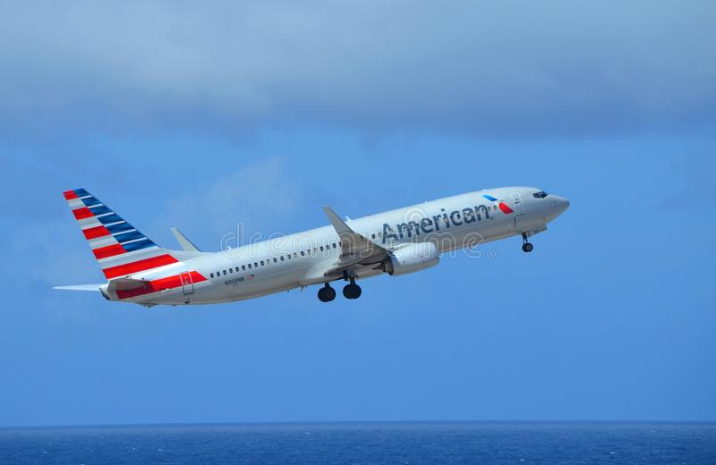 American Airlines Boeing 737-800. In the most recent livery (2015) takes off from Curacao Hato Airport on a flight to Miami, Florida stock image
