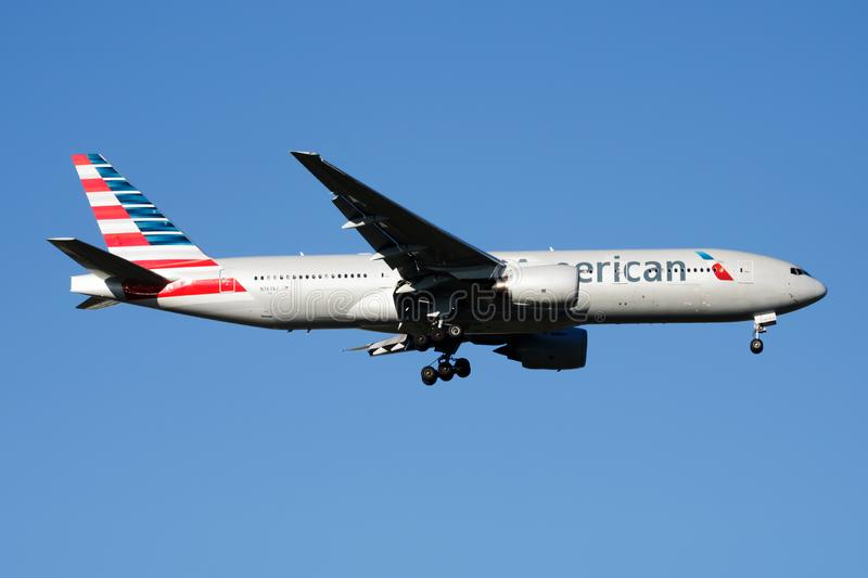 American Airlines Boeing 777-200 N767AJ passenger plane landing at Madrid Barajas Airport stock photo