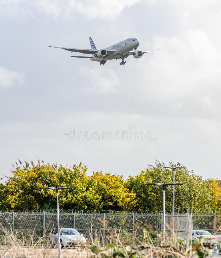 American Airways jet landing at Heathrow. October 2017 landing Gear down stock photos