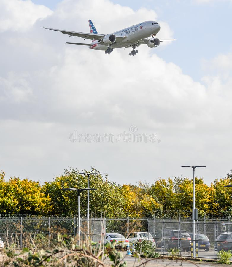 American Airways jet landing at Heathrow. October 2017 landing Gear down royalty free stock photos