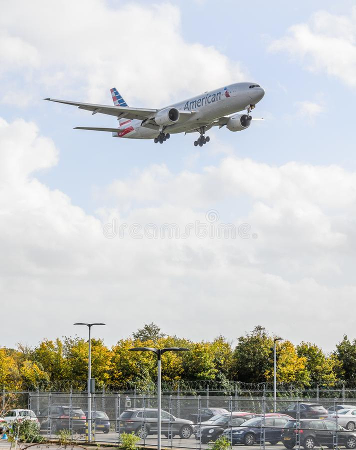 American Airways jet landing at Heathrow. October 2017 landing Gear down royalty free stock photo