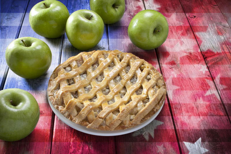 American Apple Pie Food. An apple pie with green apples on an abstract wood American flag background stock photo
