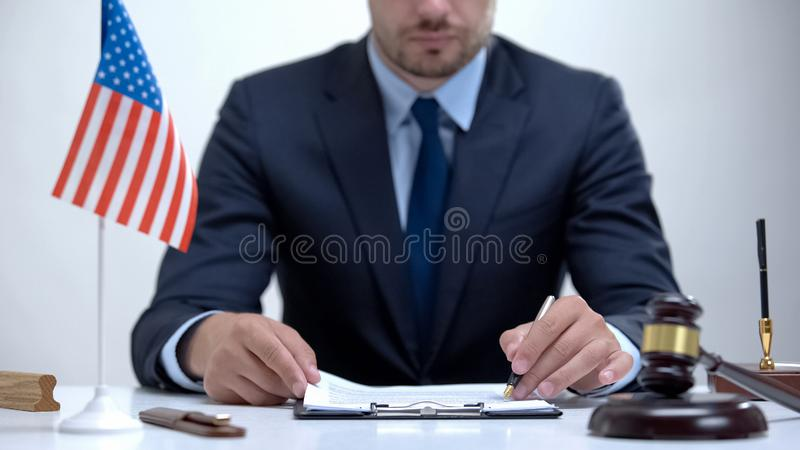 American attorney inspecting documentary evidence, making winning case strategy stock photography