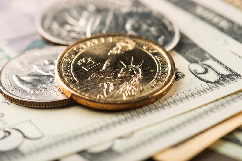 American banknotes and coins. American banknotes and us coins royalty free stock images