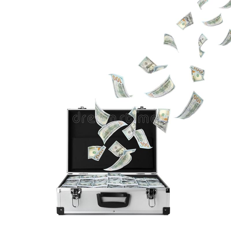 American banknotes flying out suitcase on white. Background stock photos