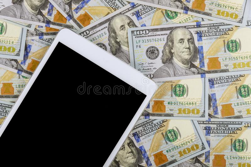 American banknotes hundred dollar bills on digital devices tablet with e-commerce concept stock image