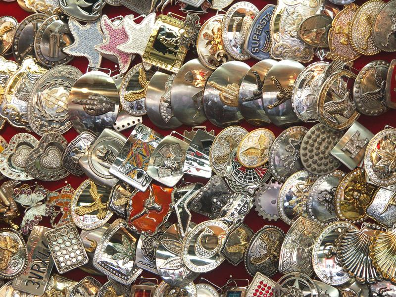 American Belt Buckles. Finely-crafted, American cast metal buckles with colorful décor stock photography