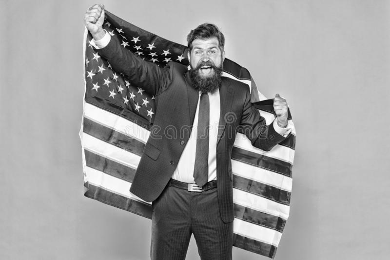 American by birth. Rebel by choice. Confident businessman handsome bearded man in formal suit hold flag USA. Business. People. Businessman concept. Successful royalty free stock photo