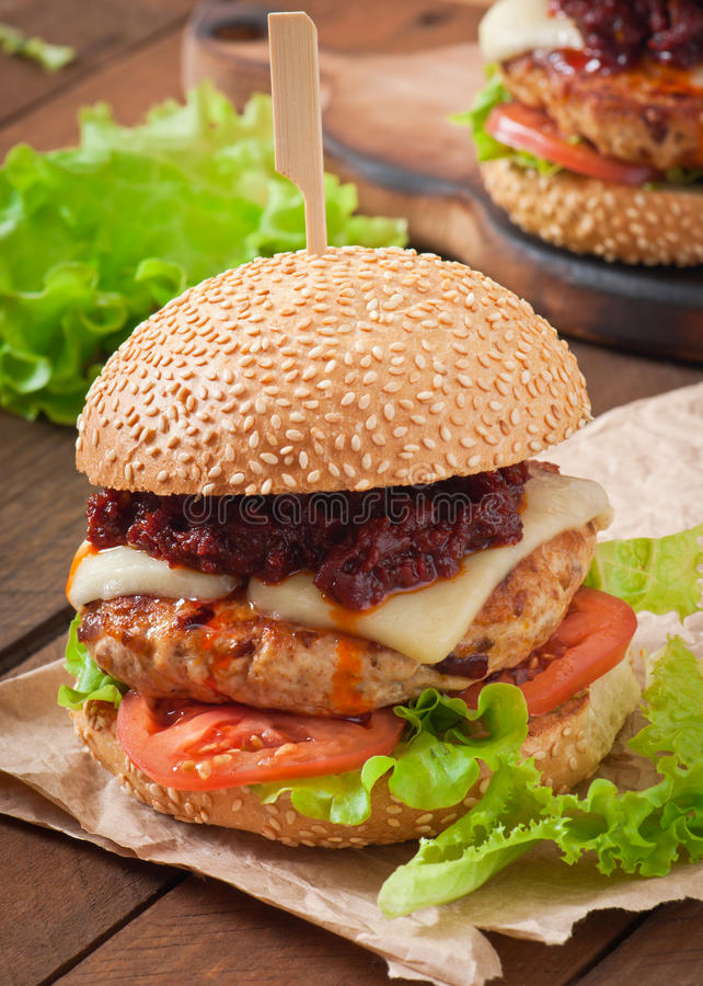 American burger with chicken and bacon. Homemade barbecue sauce stock images