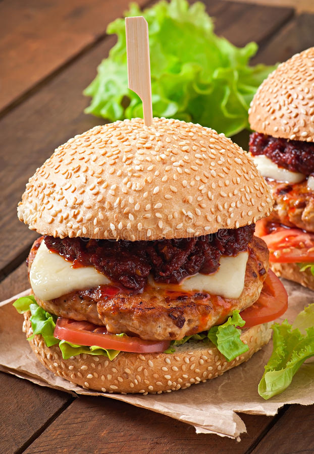 American burger with chicken and bacon. Homemade barbecue sauce royalty free stock images