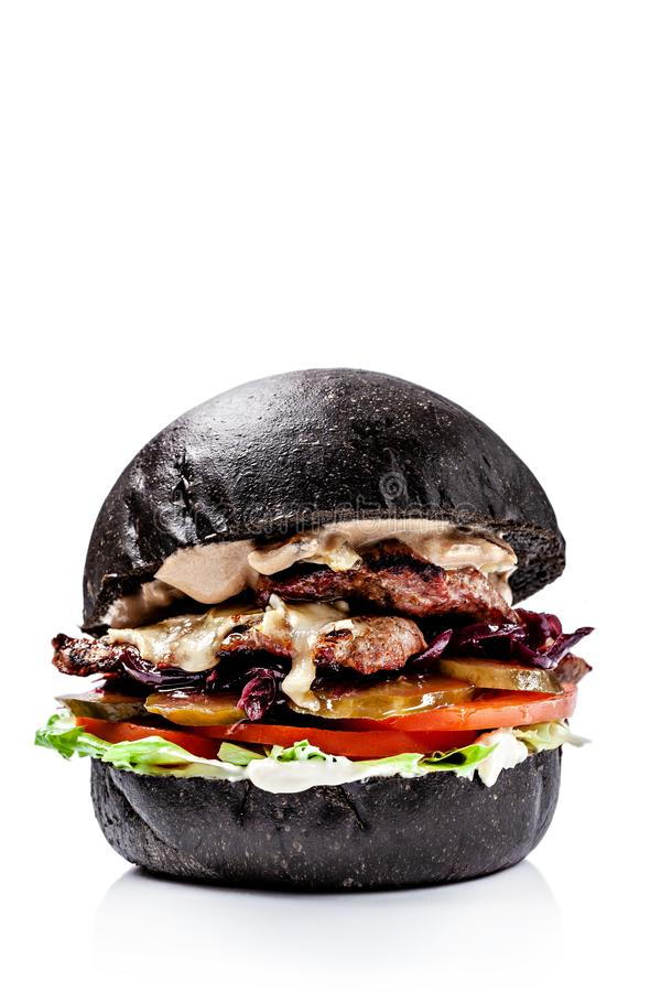 American burgers from black, red bread. With meat patty, cheddar cheese, lettuce, tomato and sous, burgers on a white background royalty free stock photos