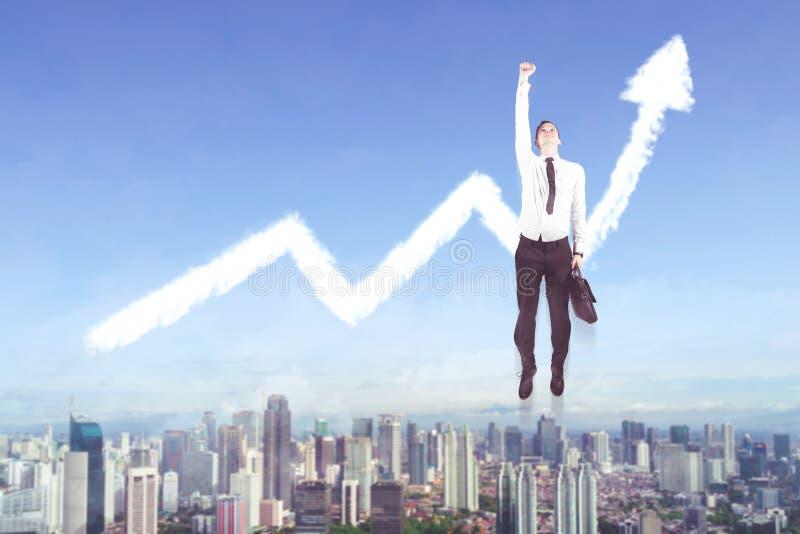 American businessman flying with upward arrow. American businessman holding a suitcase while flying with clouds shaped upward arrow stock photos