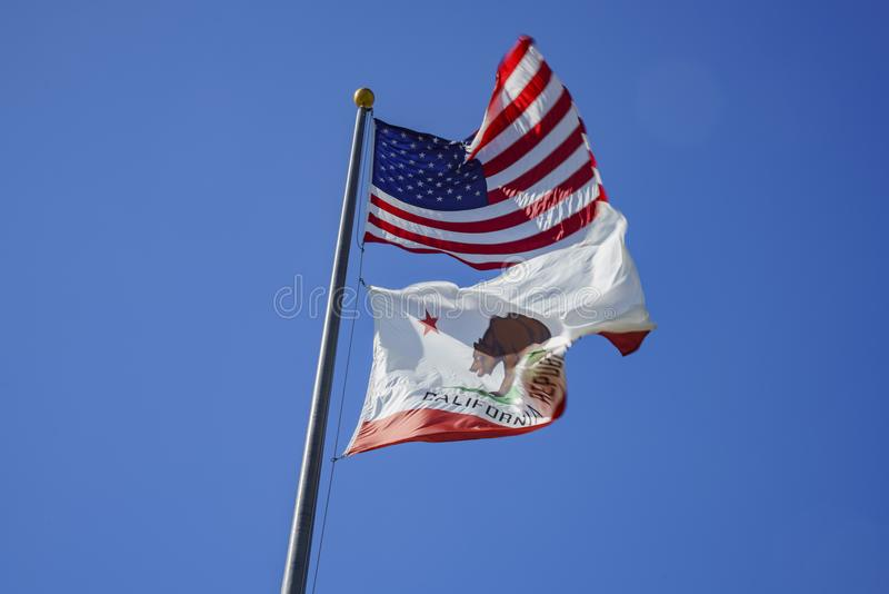 The American and California flag fluttering. Photo taken at Santa Monica, Los Angeles County, California, United States stock image