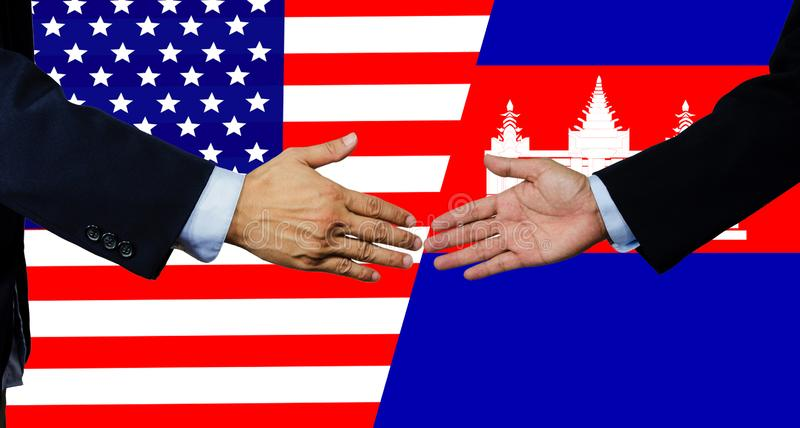 An American and   Cambodia businessman make the handshake  be the partnership royalty free stock image