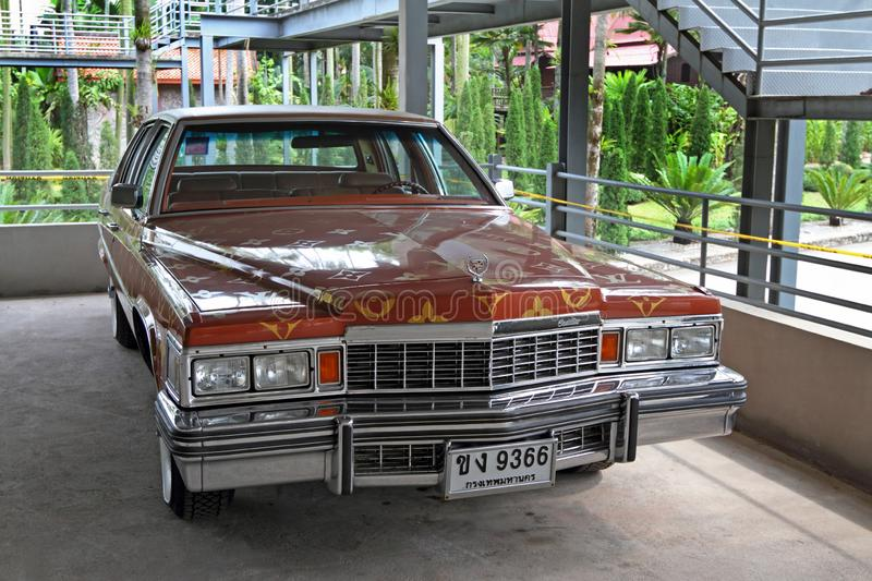 American car Cadillac DeVille with Thai rooms in the Parking lot in Pattaya Kingdom of Thailand royalty free stock photography