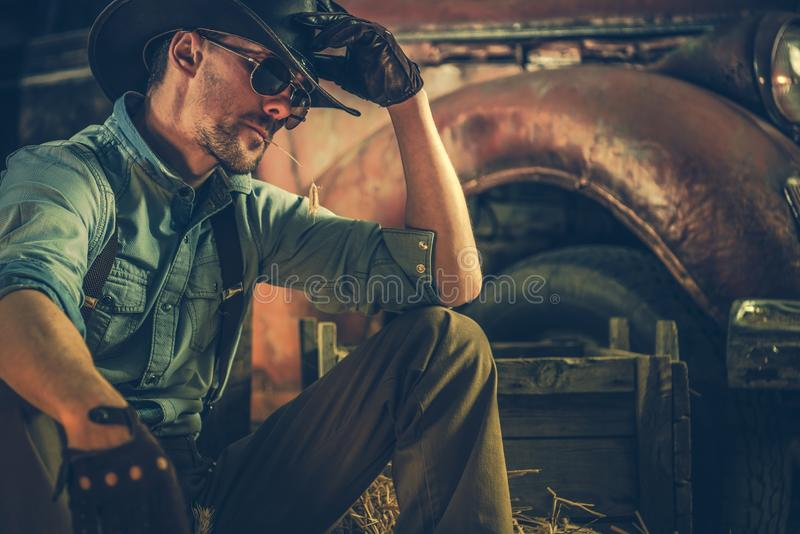 Caucasian Rancher in the Barn. American Caucasian Rancher Resting in the Barn. Countryside Theme. Cowboy and the Country stock photography
