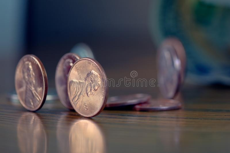 American Cent coins on wooden table stock photo