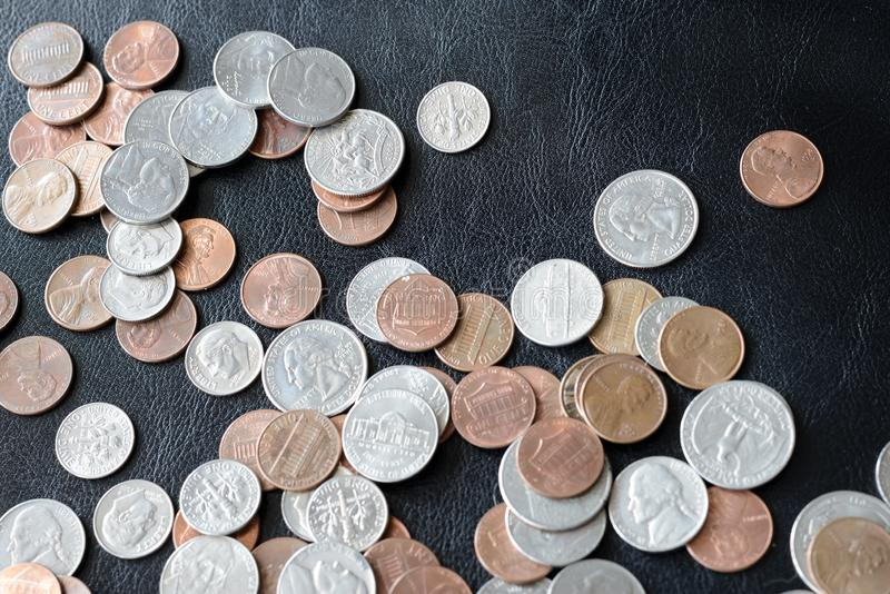 American cents scattered on a dark surface. Close up royalty free stock photos