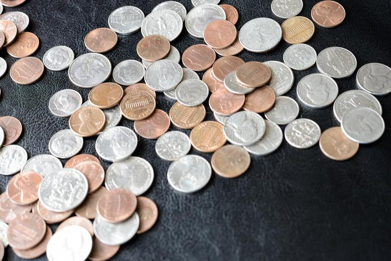 American cents scattered on a dark surface. Close up royalty free stock photo