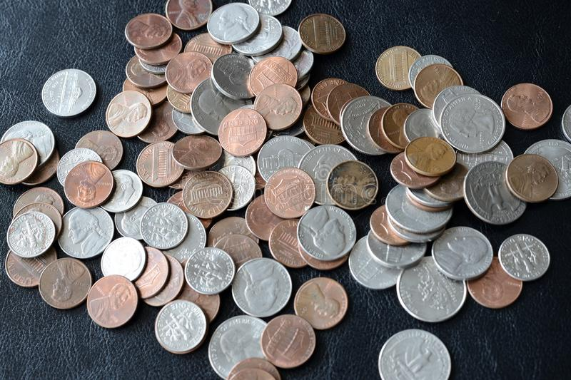 American cents scattered on a dark surface. Close up royalty free stock image