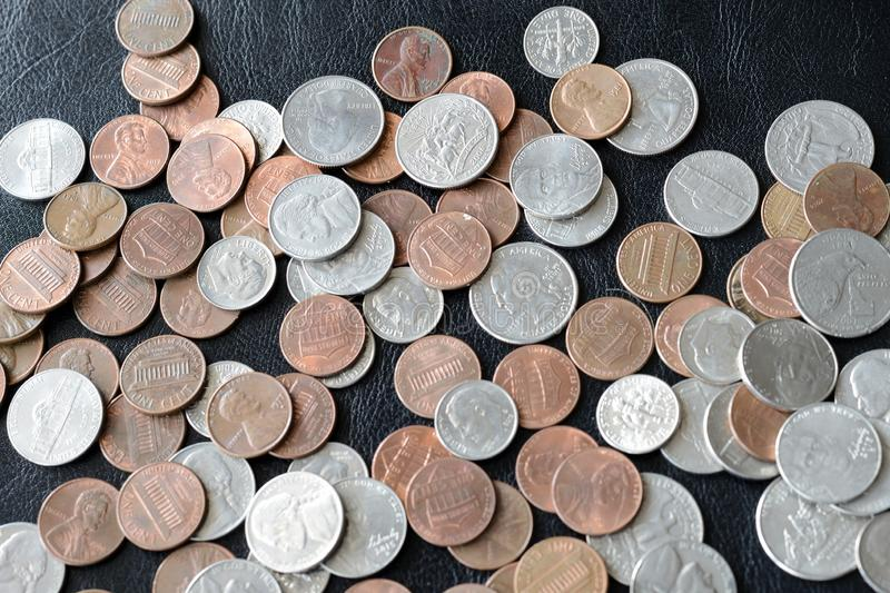 American cents scattered on a dark surface. Close up royalty free stock photography