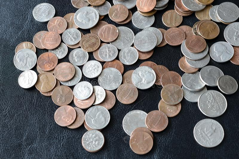 American cents scattered on a dark surface. Close up stock photo