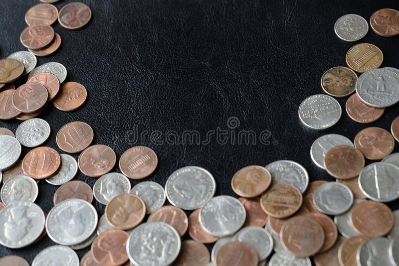 American cents scattered on a dark surface. Close up stock images