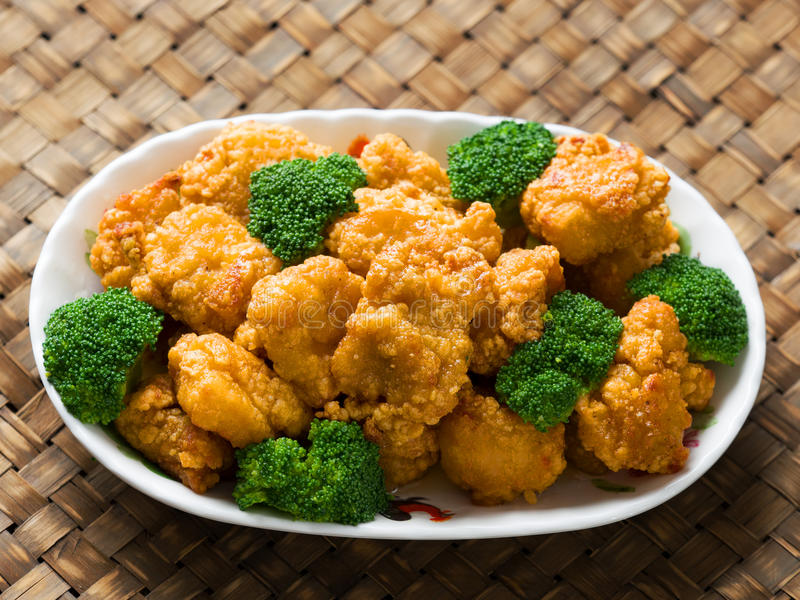 American chinese takeout general tso chicken. Close up of rustic american chinese takeout general tso chicken royalty free stock photos