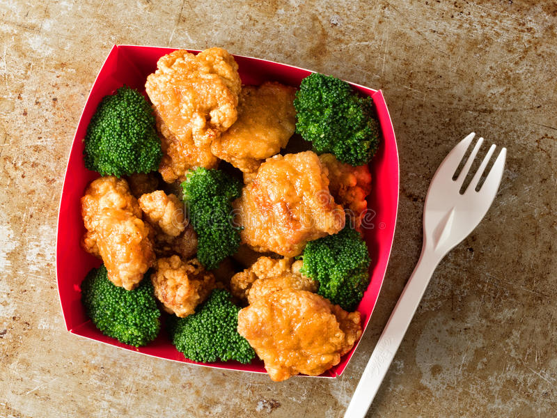 American chinese takeout general tso chicken. Close up of rustic american chinese takeout general tso chicken royalty free stock photo