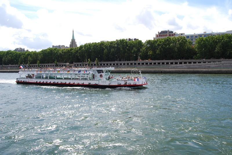 American Church in Paris, waterway, water transportation, boat, river. American Church in Paris is waterway, river and boating. That marvel has water royalty free stock photography