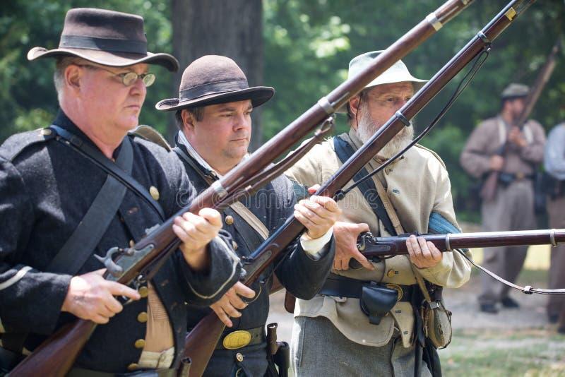 American Civil War Battle Reenactment. HUNTERSVILLE, NC - JUNE 1, 2019 USA:  Closeup of reenactors in Confederate army uniforms during an American Civil War stock photography