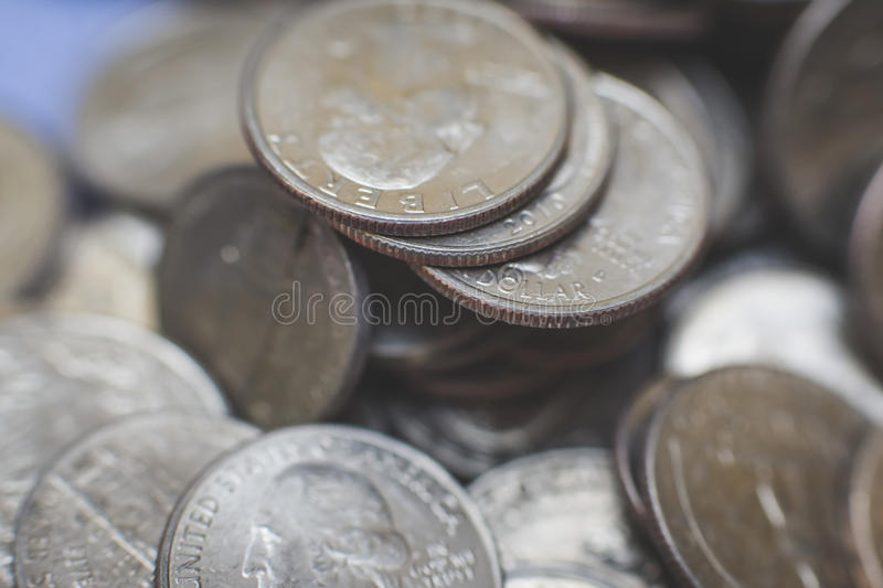 American coins background. A lot of american dollars and cents. Dollar coins background stock photography
