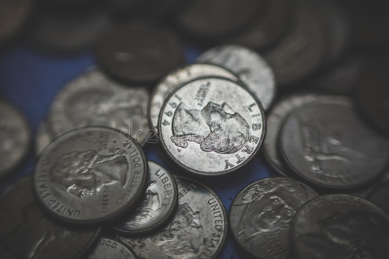 American coins background. A lot of american dollars and cents. Dollar coins background royalty free stock image