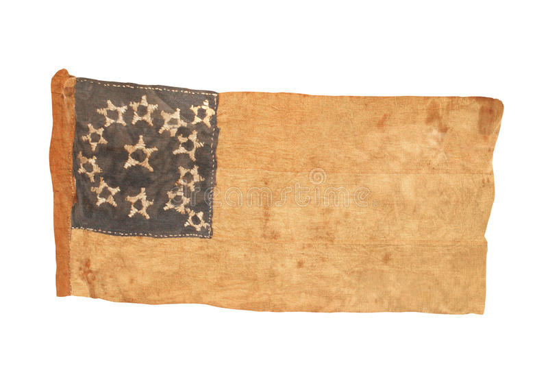 American colonial flag isolated. Worn and tattered American cloth colonial flag, with thirteen stars. Isolated on white stock photos