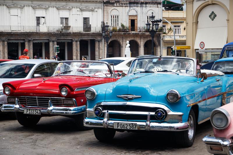 American convertible vintage cars parked on the main street in Havana Cuba. royalty free stock images