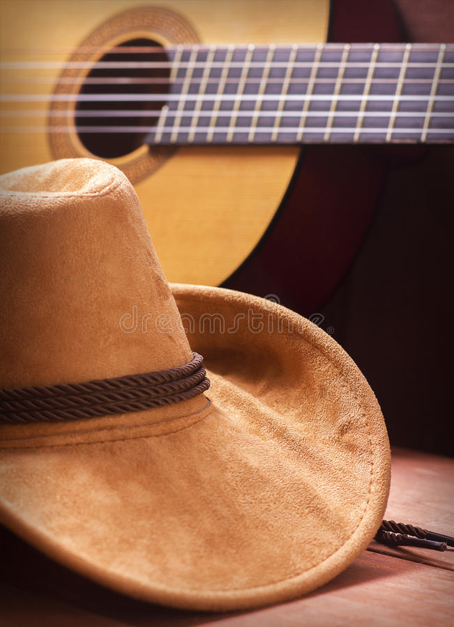 American Country music background with cowboy hat. American Country music picture with cowboy hat and guitar royalty free stock photo