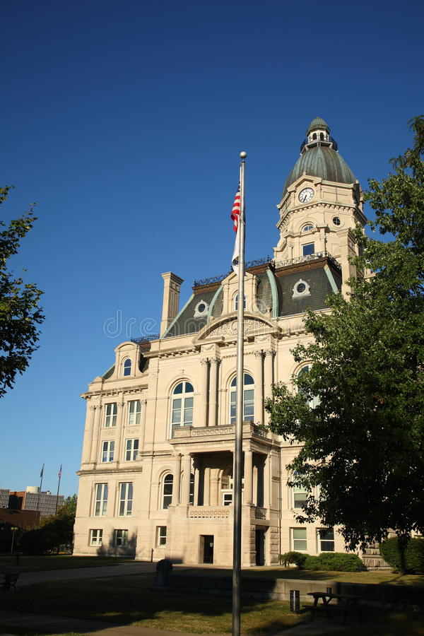 American Courthouse and Flag. Vigo County Courthouse in Terre Haute, Indiana, in the National Register of Historic Places royalty free stock photography