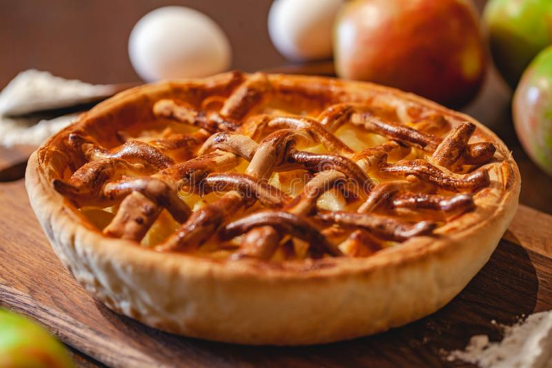 American cuisine. Homemade apple pie on wooden background. Classic autumn Thanksgiving dessert. Close up royalty free stock photo