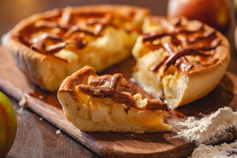 American cuisine. Homemade apple pie on wooden background. Classic autumn Thanksgiving dessert. Close up stock images